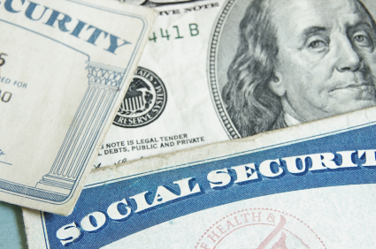 social security cards with dollar bill