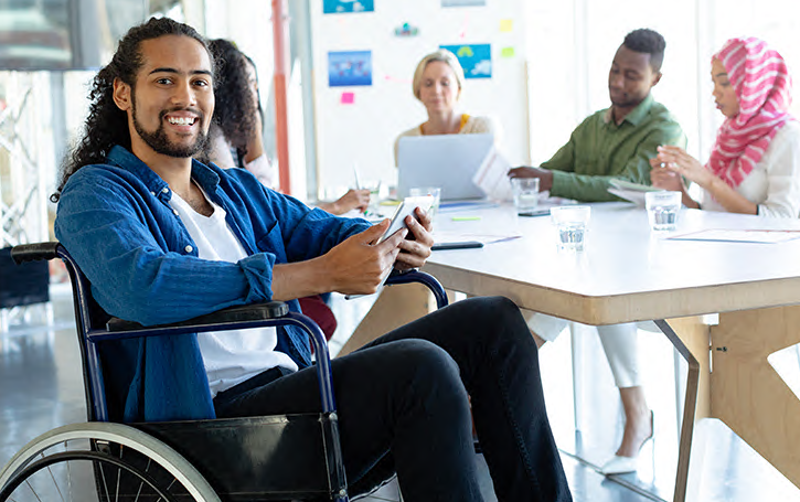 man in wheelchair sitting with a group of people