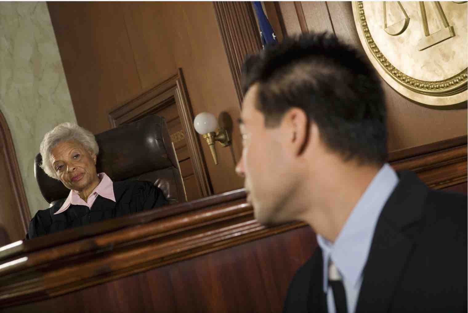 Businessman in law court with the judge