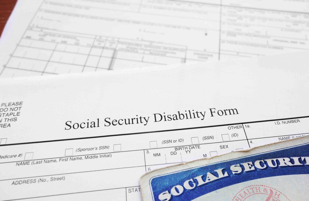 A social security disability form and a social security card