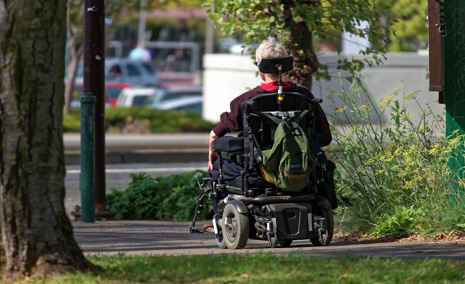 Backview of a senior sitting in a motorized wheelchair