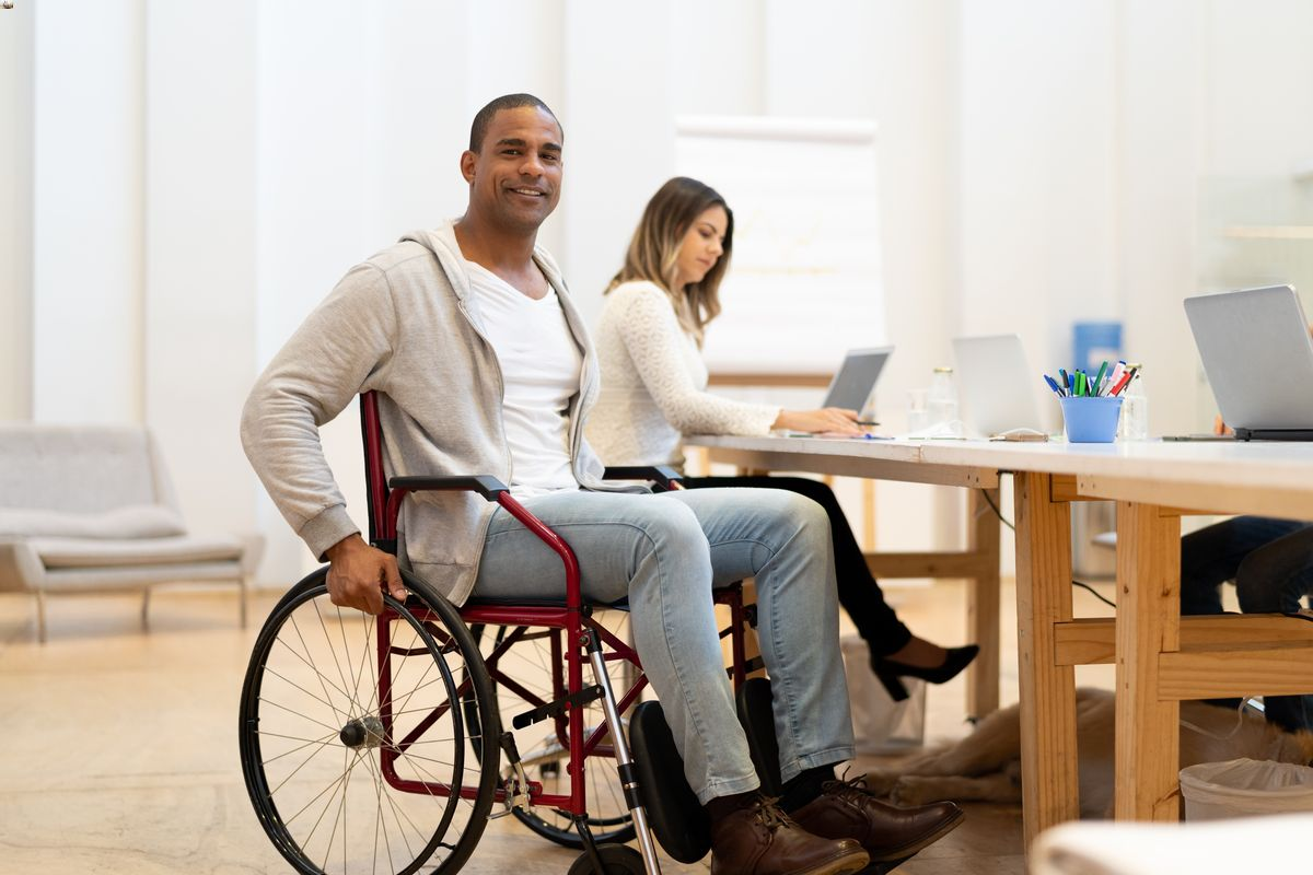 Disabled man in wheelchair at workplace