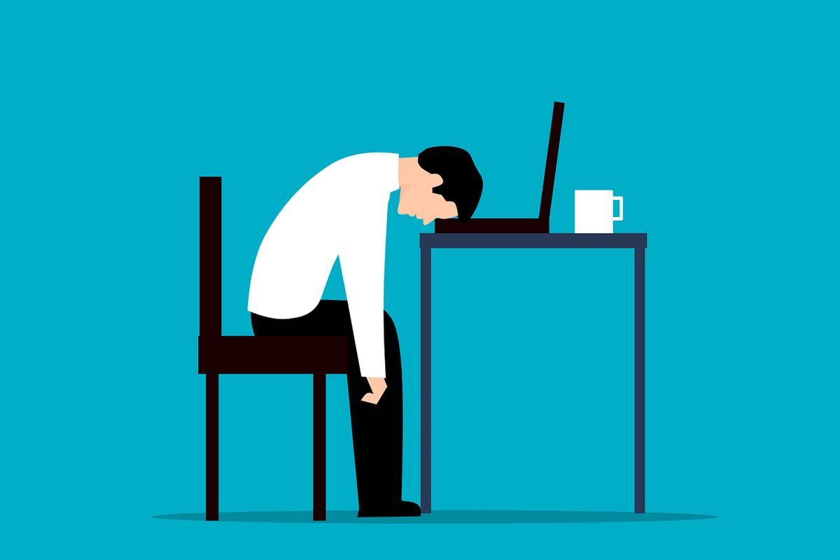 Cartoon of a worker fall asleep on work desk